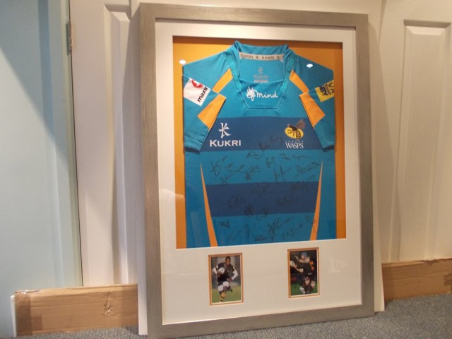 Signed Wasps Rugby Shirts and match day photos in a box frame.