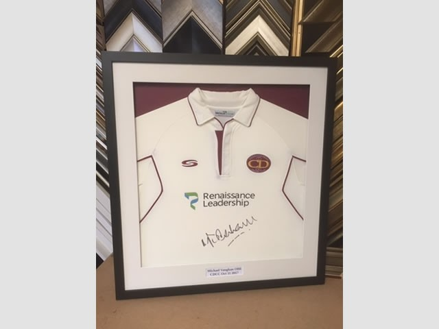 Cricket shirt signed by England's Micheal Vaughan in a Matt black box frame.