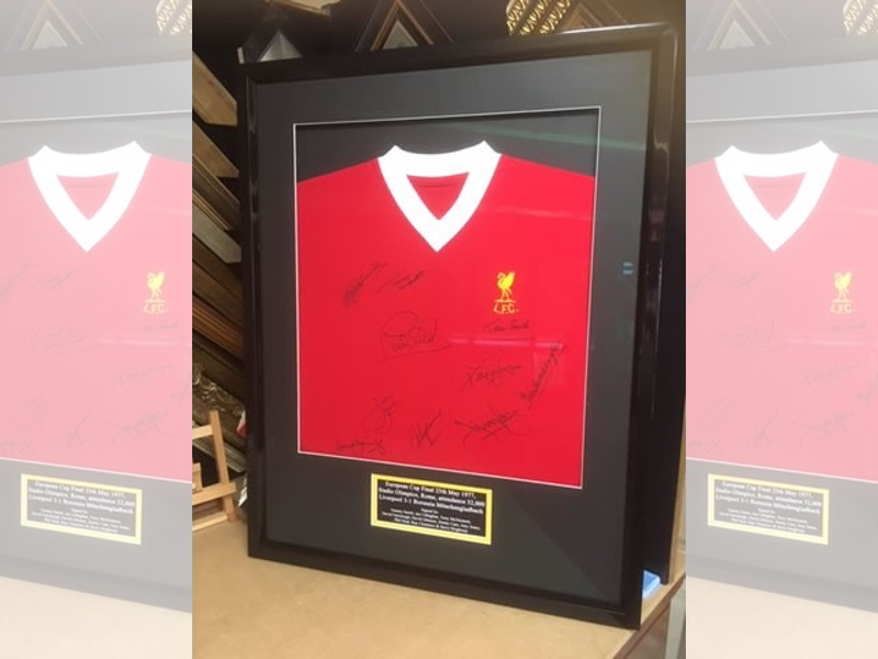 A signed 1977 Liverpool European Cup Final shirt framed in black gloss box frame