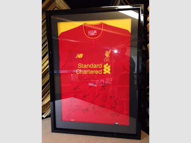 Signed Liverpool FC shirt from 2016/17 season in  a black gloss box frame.