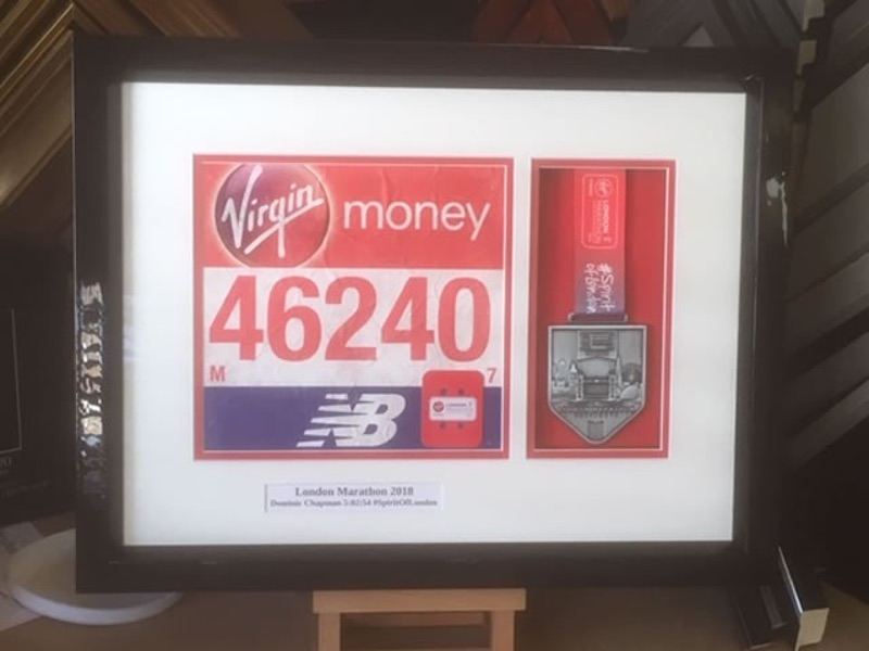 London Marathon Medal and Running Number presentation display for Dominc Chapman of the Beehive in White Waltham