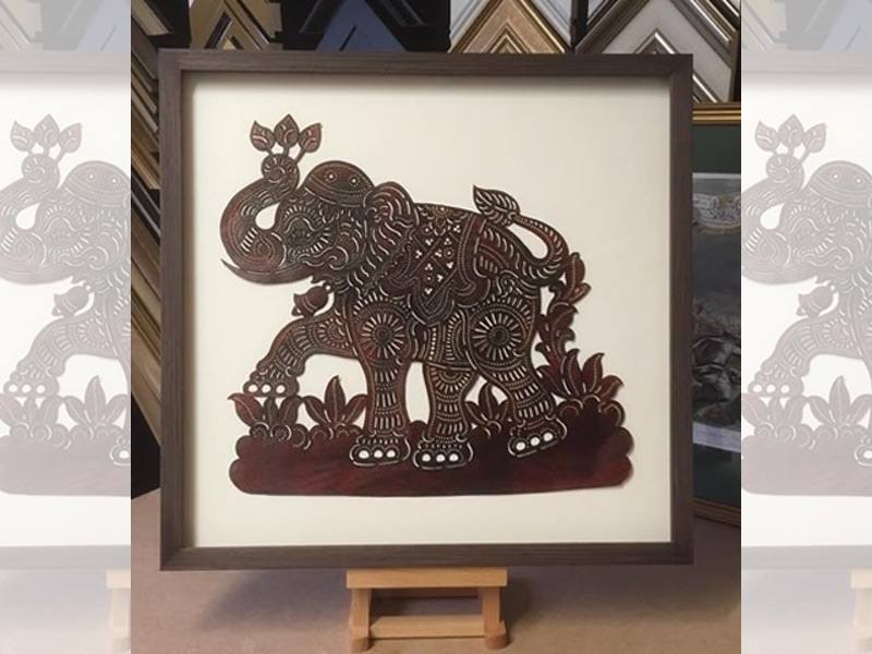 Cambodian artefacts, float mounted and framed with a oak box frame