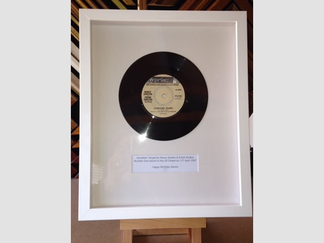 Somethin' Stupid by Nancy and Frank Sinatra record framed in a box