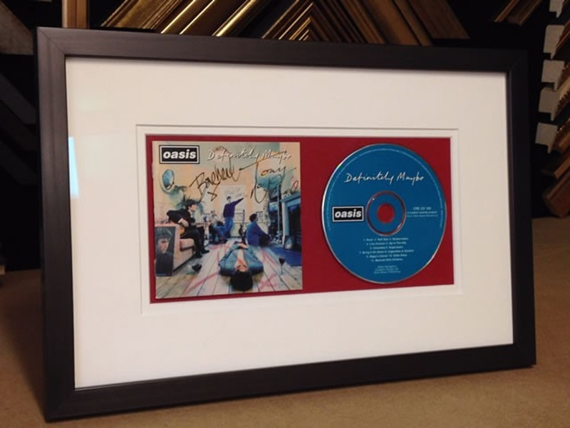 Oasis Definitely Maybe Signed CD Cover in a Boxed Frame